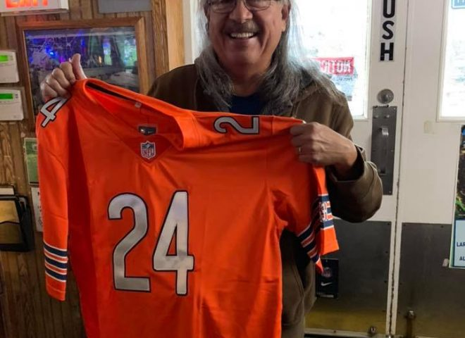 November 2018 - Bears fan Redbone showing off his new official Jordan Howard jersey.